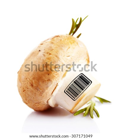 Fresh mushroom with barcode isolated on white - stock photo