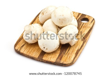 Fresh mushrooms on wooden board isolated on white background - stock photo