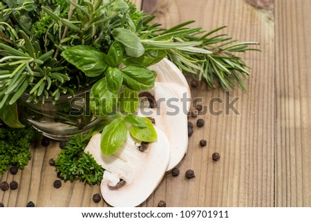 Fresh Mushrooms with Herbs on wooden background