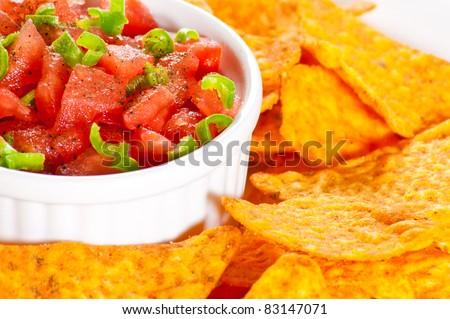 Fresh nachos served with hot salsa - stock photo