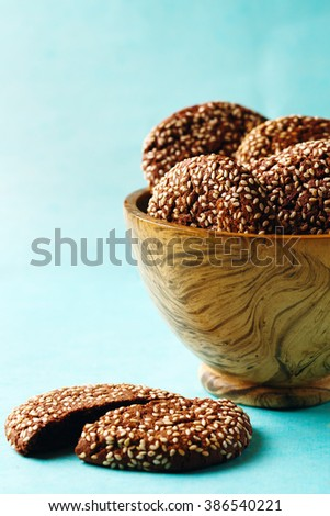 Fresh Natural Homemade Crispy Cookies with Sesame on Blue Background. Selective Focus. - stock photo