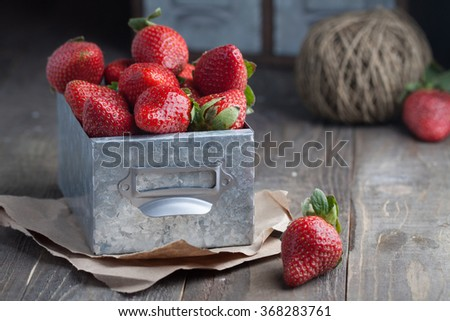 Fresh natural strawberry in a metal rustic box - stock photo