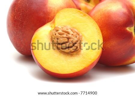fresh nectarine on white background - stock photo