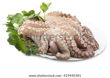 fresh octopus with potatoes and parsley on white plate - stock photo