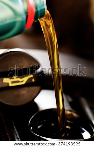 Fresh oil being poured during an oil change to a car - stock photo