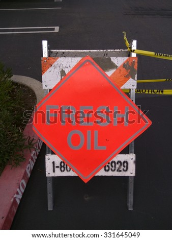 Fresh Oil sign usually refers to the tack pavers use before laying the asphalt. - stock photo