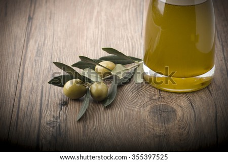 Fresh olives and leaves on the wooden table - stock photo