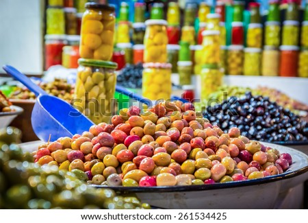 Fresh olives and preserves at moroccan market in Marrakesh - stock photo