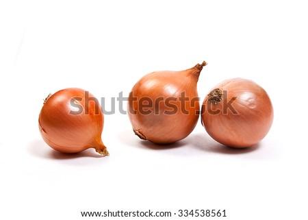 Fresh onions vegetables on white background. Arrangement of three ripe fresh onions isolated on white background. - stock photo