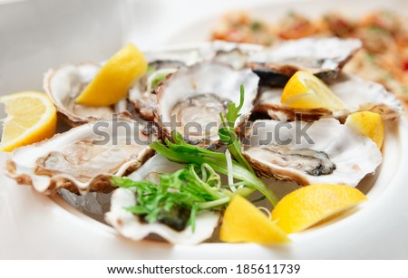 Fresh opened oysters on restaurant table - stock photo