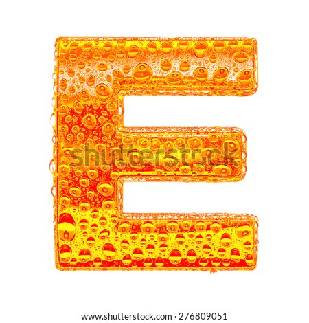 Fresh Orange alphabet symbol - letter E. Water splashes and drops on transparent glass - color of brandy , cognac, liquor, cola, beer or tea. Isolated on white - stock photo