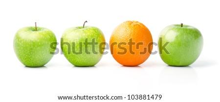 Fresh Orange Among Green Apples, Isolated on White - stock photo