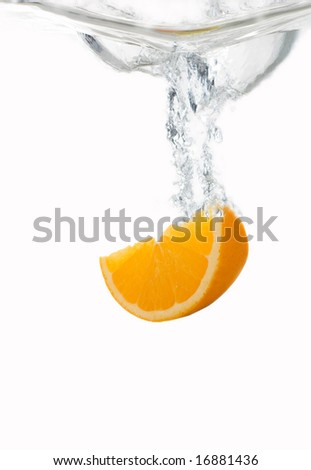 Fresh orange diving into water with a splash - stock photo