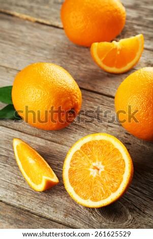 Fresh orange fruit on grey wooden background - stock photo