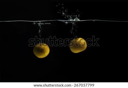 Fresh orange in water splash - stock photo