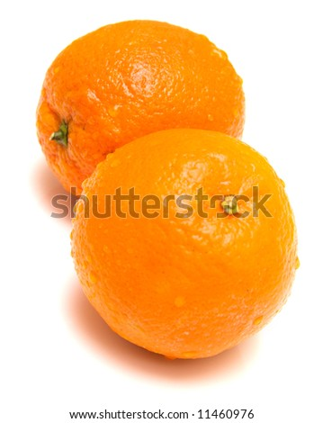 Fresh orange is covered by drops of water. Isolation on white, shallow DOF. - stock photo