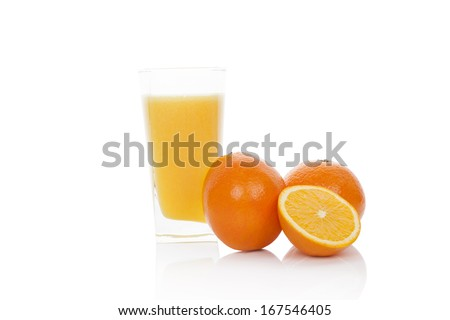 Fresh orange juice. Fresh oranges and orange juice in glass isolated on white background with reflection. Healthy fruit juice drinking.