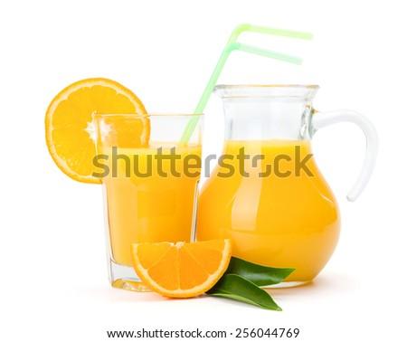 Fresh orange juice in glass and jug - stock photo