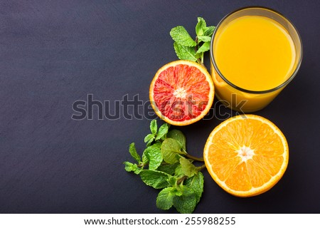 Fresh orange juice on dark background, top view, copy space - stock photo