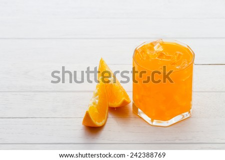 Fresh orange juice, organic from natural at on white  wooden table
