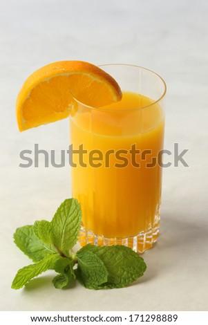Fresh Orange Juice with Mint and Orange Slice Garnish - stock photo