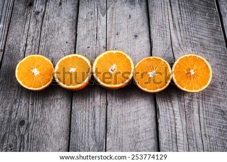 fresh, orange on  a wooden background - stock photo