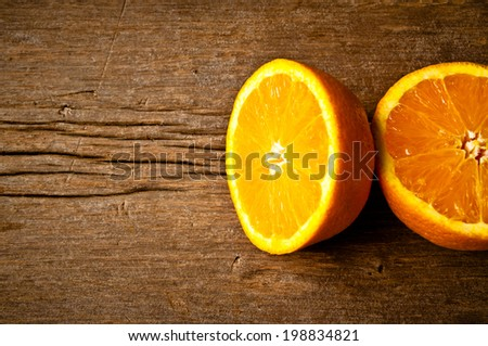 Fresh Orange on Wood Table Desk Background, Rustic Style. - stock photo