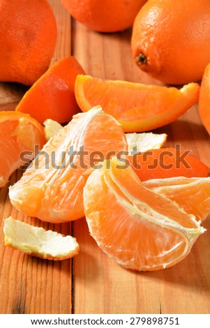 Fresh orange wedges on a rustic wooden table