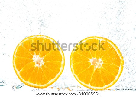 fresh orange with bubbles in the water - stock photo