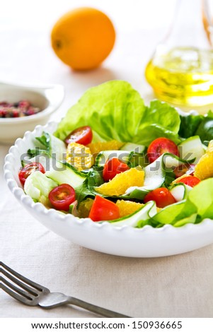 Fresh Orange with cherry tomato and lettuce salad