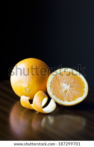Fresh Oranges and Peel on a wooden table - stock photo