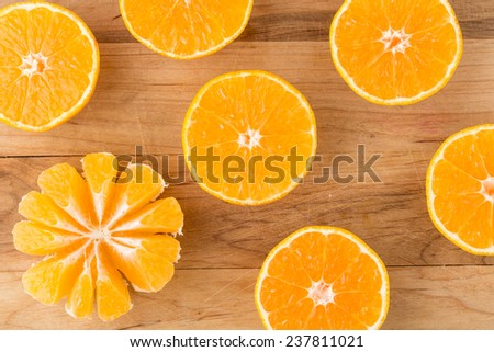 fresh oranges cut in half on cutting board. Top view. Horizontal image.
