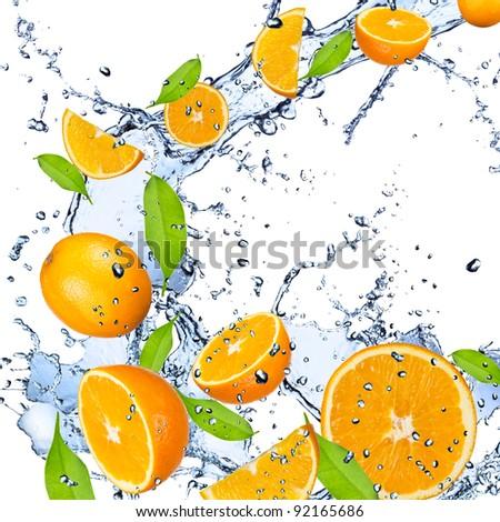 Fresh oranges falling in water splash - stock photo