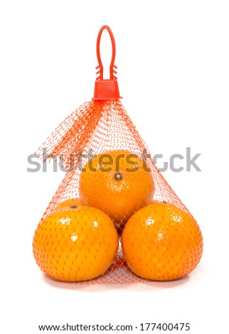 Fresh Oranges in Plastic Mesh Sack on White Background - stock photo