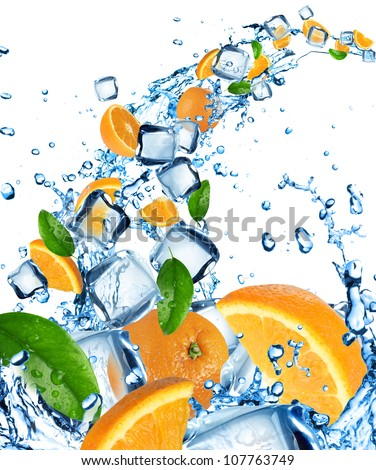 Fresh oranges in water splash with ice cubes - stock photo
