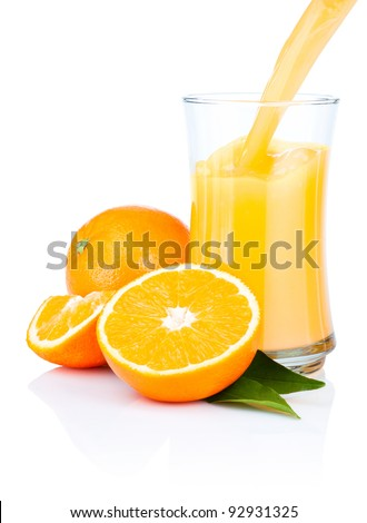 Fresh Oranges Juice Pouring into a Glass Isolated on white background - stock photo