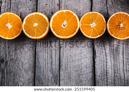 fresh, oranges on  a wooden background - stock photo