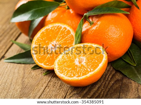 Fresh oranges on a wooden table - stock photo