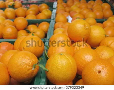Fresh oranges on the market - stock photo