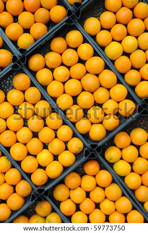 Fresh oranges on the market placed in boxes