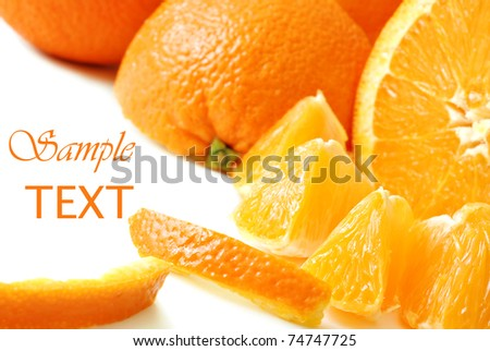 Fresh oranges on white background with copy space.  Macro with shallow dof. - stock photo