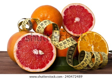 fresh oranges with tape, healthy diet - stock photo