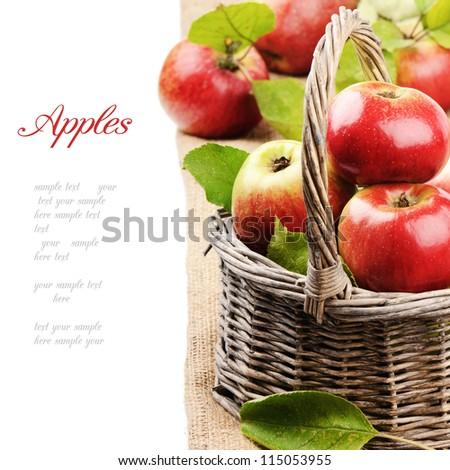 Fresh organic apples in wicker basket - stock photo