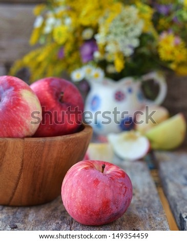 fresh,organic apples on the wooden background