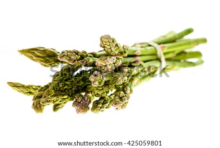 Fresh organic asparagus isolated on white background. Eating Natural healthy food for less healthcare and medical problems. - stock photo