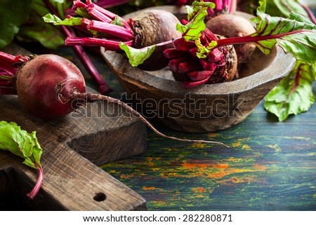 Fresh organic beetroot with green leaves. soft focus - stock photo