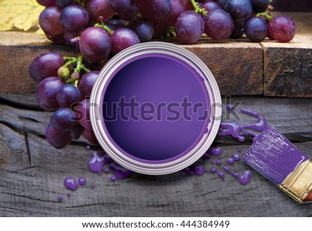 Fresh organic black bunches of grapes in a bowl. Rustic style. Paint, paint brush. - stock photo