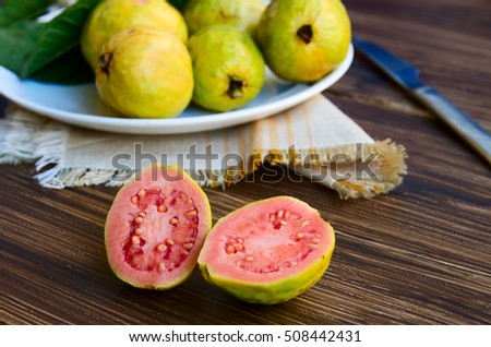 How to eat guava stock images royalty free images vectors fresh organic brazilian guava cut in half in front of some entire guavas on rustic wood ccuart Gallery