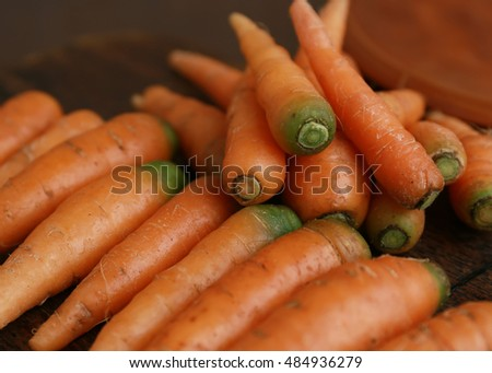 Fresh organic carrot on wooden background,Selective focus.