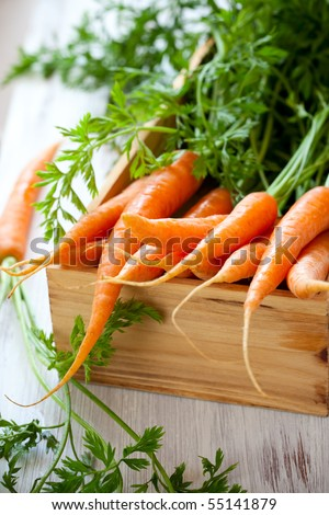 Fresh organic carrots in a wooden  box - stock photo